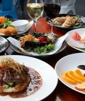 Japanese Dinner with Sake for Two ($59), Four ($118) or Six People ($177) at Claire's Gallery (Up to $342 Value)