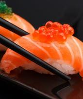 $17.80 for Sushi Train Lunch - Choice of Four Plates, Gyoza and Dessert at Umi Sushi Express (Up to $39.70 Value)