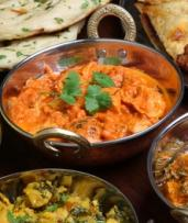 Three-Course Indian Dinner for Two ($29) or Four People ($55) at Satguru's Indian Restaurant (Up to $169 Value)