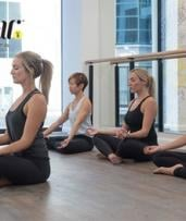 $14 for 2 Weeks of Unlimited Yoga, Barre and Pilates Classes at Choice of Seven Locations with YogaBar (Up to $35 Value)