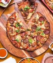 Takeaway Meal Combo with 2 Regular Pizzas ($20) or 2 Party Pizzas and Dessert ($50) at Amigo's Pizzeria (Up to $95.20)