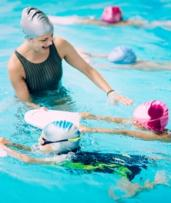 Kids Swimming Classes: Five ($39) or Ten ($65) + $15 Admin Fee at The Swim School, Three Locations (Up to $210 Value)