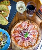Garlic Bread, Pizza or Pasta with Wine for Two ($39) or Four People ($75) at Baia The Italian (Up to $188 Value)