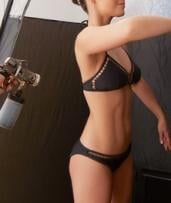 Spray Tanning: One ($24), Two ($47) or Three Sessions ($69) at Home of Beauty (Up to $120 Value)