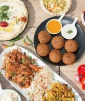 Lebanese Banquet for Two ($39) or Four People ($75) at Hello Dolly Lebanese Restaurant (Up to $180 Value)