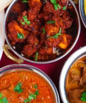 Indian Dinner with Sides and Wine for Two ($39) or Four People ($78) at Maharajah's Kitchen (Up to $163.40 Value)
