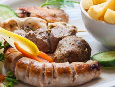 Greek Seafood or Meat Platter with Wine is $39 for Two People, $75 for Four, $105 for Six or $135 for Eight (Valued Up To $316)
