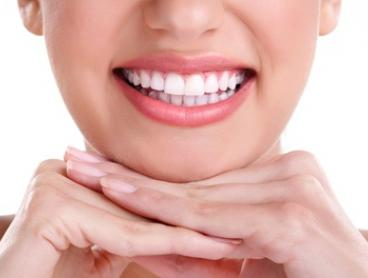 Teeth Whitening Treatment: 30 Minutes ($59) or 60 Minutes ($79) at Skin First Laser Treatment Experts (Up to $400 Value)