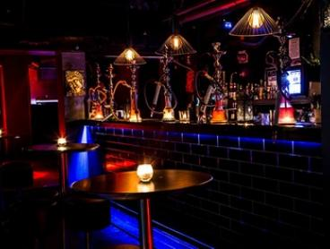 Shisha, Cocktails, and Pizza for Two ($39) or Four People ($75) at Marrakech Lounge & Cocktail Bar (Up to $152 Value)