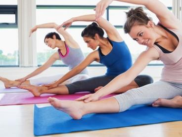 $29 for a Seven-Class Yoga Pass or $85 with One-Hour Massage at The Pure Yoga & Wellbeing Centre (Up to $225 Value)