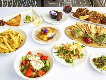 Seven-Course Greek Feast with Wine for Two ($59) or Four People ($115) at ENA Greek Street Food (Up to $272 Value)