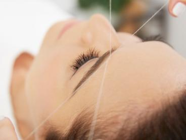 Eyebrow or Full Face Threading: One ($19) or Two Visits ($35) at The Laser Hair and Beauty Home (Up to $130 Value)