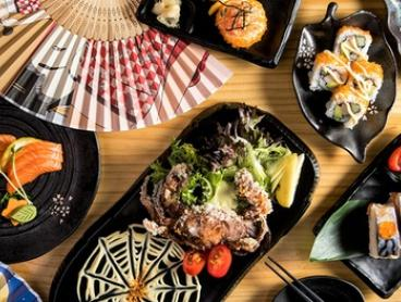 Japanese Dining Experience with Sake for Two ($39) or Four People ($75) at Katana Sushi Train (Up to $169.40 Value)