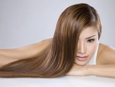 $29 Cut and Treatment, $59 with Balayage, or $79 with Full Head of Foils at Artique Hair & Beauty (Up to $210 Value)