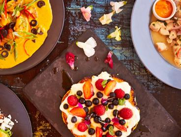 South American Breakfast or Dinner for Two People in Newtown: $28 for Breakfast with Coffee or an Exotik Soft Drink, or $59 for Dinner with Sangria (Valued Up To $87)