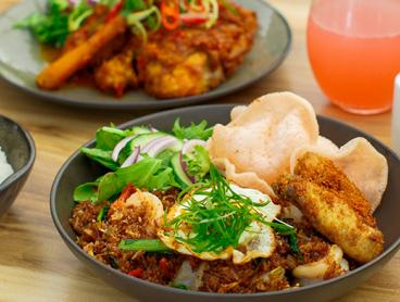 Three-Course Indonesian Dinner with a Bottle of Wine per Couple is Just $49 for Two People or $95 for Four People (Valued Up To $242.40)