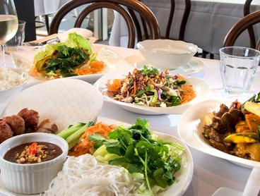 Authentic Six-Dish Vietnamese Banquet with a Glass of Wine Each - $59 for Two People or $89 for Four (Valued Up To $224)