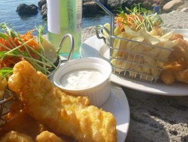 Fish and Chips with Wine for 2 ($35) or 6 People ($103) at Nino's Fish Bar and Cafe, 2 Locations (Up to $203 Value)