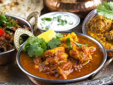 Three-Course Indian Dinner with Sides and a Glass of Wine Each is $35 for Two People, $65 for Four or $85 for Six (Valued Up To $321.30)