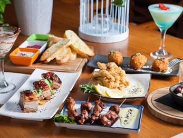 $49 for Six Tapas Dishes with Wine, or $59 with Cocktails for Two People at Ultra Lounge Bar & Cafe (Up to $103 Value)