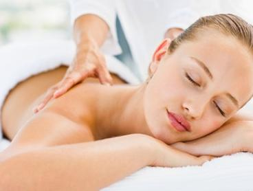 115-Min Pamper with Hot Stone Massage and Facial - One ($59) or Two Visits ($115) at Grain de Beauty (Up to $390 Value)