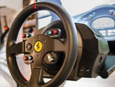 30-Minutes in V8 Racing Simulator: One ($19) or Two People ($35) at Simulator World (Up to $78 Value)