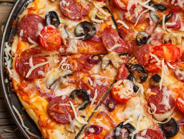 Epic Pizza Feast with Side Salads and Drinks is $29 for Two People or $55 for Four People (Valued Up To $140)