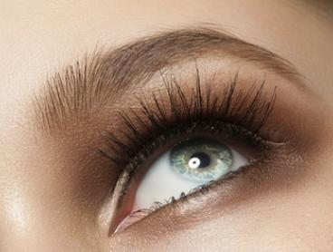 Brow + Lash Package or Face Threading - One ($19) or Three Visits ($49) at Eminence Brows and Beauty (Up to $150 Value)