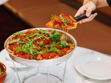Chicago Deep Dish Pizza Meal and Drink for One ($10), Two ($32) or Four ($62) at Johnny Fontane's Bar (Up to $104 Value)