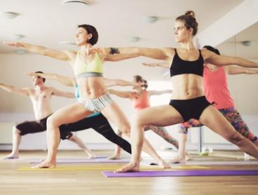10 Class Yoga Pass for 1 ($29) or 2 ($55) or 15 Classes for 1 ($39) or 2 ($69) at Raw Power Yoga (Up to $540 Value)