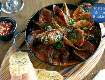 Five-Course Tapas Meal with Sangria for Two ($49) or Six People ($145) at El Toro Tapas & Pizza Bar (Up to $270 Value)