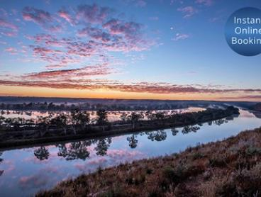 Walker Flat: Up to 7 Nights for Up to 12 People with Late Check-Out, Wine + Tennis Equipment Hire at Aruma River Resort