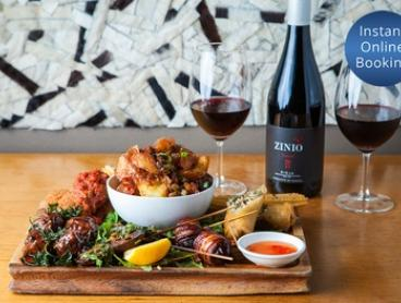 Tapas Platter + Bottle of Spanish Wine: Two ($59), Four ($115) or Eight People ($225) at Toro Bravo (Up to $360 Value)