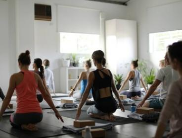 Five-Class Yoga Pass for One ($9) or Two People ($15) at Divine Flow Yoga (Up to $200 Value)