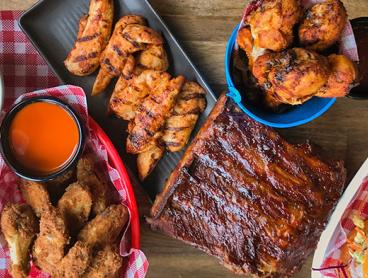 Epic Burger Platter with Ribs, Wings, Drumsticks, Wedges & More! One Platter for Two People is $49, or Two Platters for Four People is $95 (Valued Up To $183)