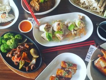 Asian Banquet with Glass of Beer or Wine for Two ($39) or Four People ($75) at KaChin (Up to $165 Value)
