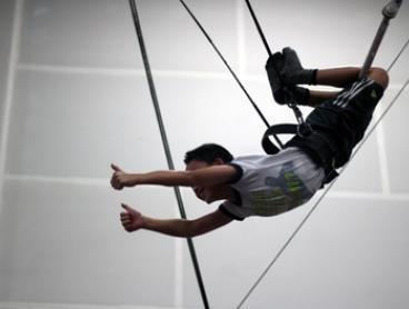 Two-Hour Adult Trapeze Fly Session for One ($44), Two ($77) or Three People ($99) at Rooftop Trapeze (Up to $198 Value)
