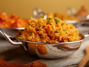 Two-Course Indian Meal with Sides and Drinks for Two ($35) or Four People ($69) at Aromas Of India (Up to $120.30 Value)