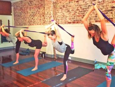 One-Month Unlimited Yoga Classes for One ($19) or Two People ($35) at OM Power Yoga (Up to $358 Value)