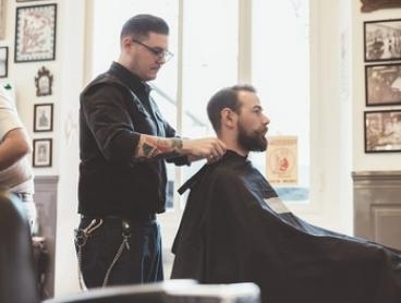 Style Cut ($15) or Hair, Shave and Facial Package ($45) at The Gentlemen's Club Barber Shop (Up to $89 Value)