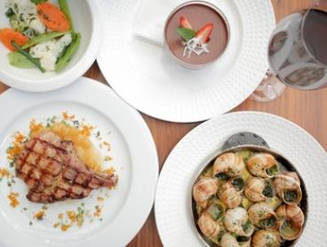 $75 for Three-Course French Dining with Wine for Two People at La Grillade (Up to $164.50 Value)