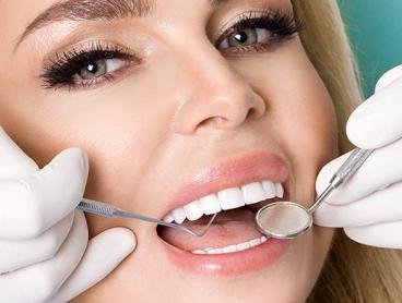 $59 for a Dental Exam for One Person with Clean, Scale and Dental Photos or a Teeth Whitening Session for One Person