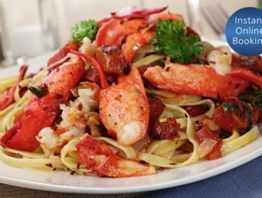 Christmas or New Year''s Eve Buffet with Lobster Alfredo at IGG International Buffet and Bar (Up to $264 Value)