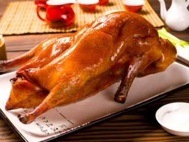 Peking Duck Set with Wine for Two ($69) or Four People ($135) at Aja Restaurant (Up to $246 Value)