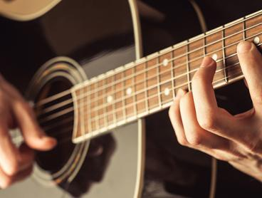 Three 30-Minute Private Music Lessons in Mitchell - $29 for One Person or $55 for Two People. Learn Guitar, Drums, Keyboard or Electronic Music (Value Up To $300)