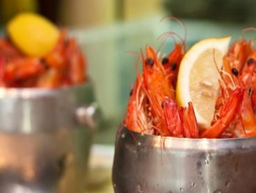 Buckets of Prawns with Bottles of Wine for 2 ($35), 4 ($69) or 6 People ($99) at Blue Fish Restaurant (Up to $261 Value)