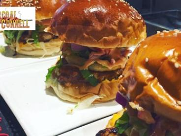Choice of Gourmet Burger with Small Fries for One ($15) or Two People ($29) at Charcoal On O'Connell (Up to $44 Value)