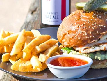 Beachside Lunch or Dinner with a Cocktail, Wine or Beer Each is Just $49 for Two People or $69 for a Family of Four (Valued Up To $161.80)
