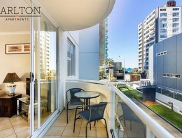 Gold Coast, Surfers Paradise: 3 or 5 Nights for Four with Wine and Late Check-Out at Carlton Apartments