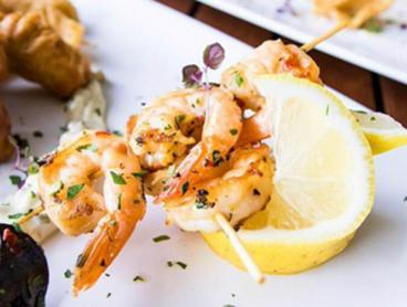 Waterfront Seafood Banquet with Salt & Pepper Squid, Mussels, Barramundi and More - $59 for Two People or $115 for Four People (Valued Up To $242)